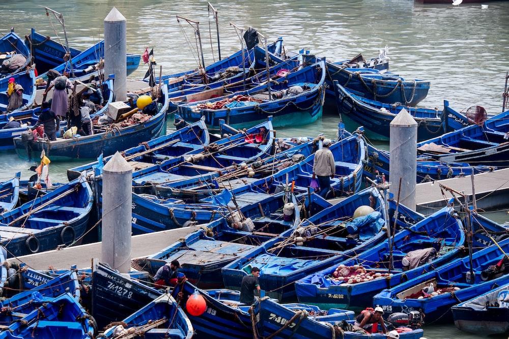 blue boats on pier
