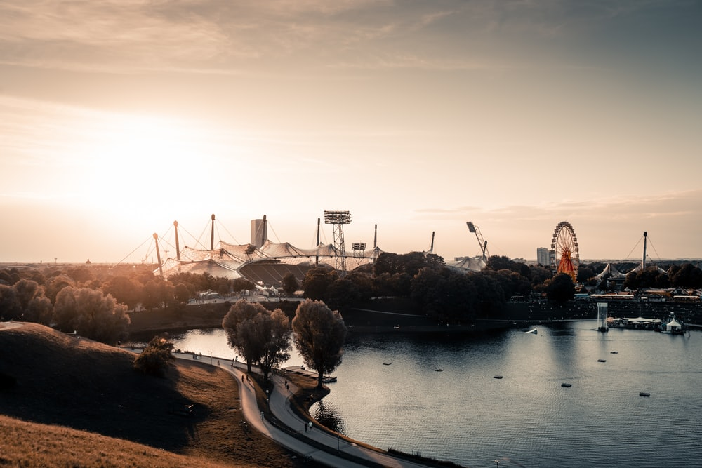 high-angle photo of carnival beside body of water