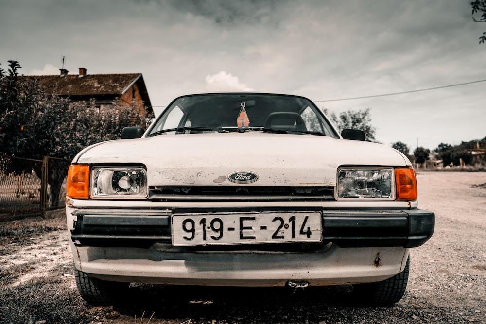 white Ford car