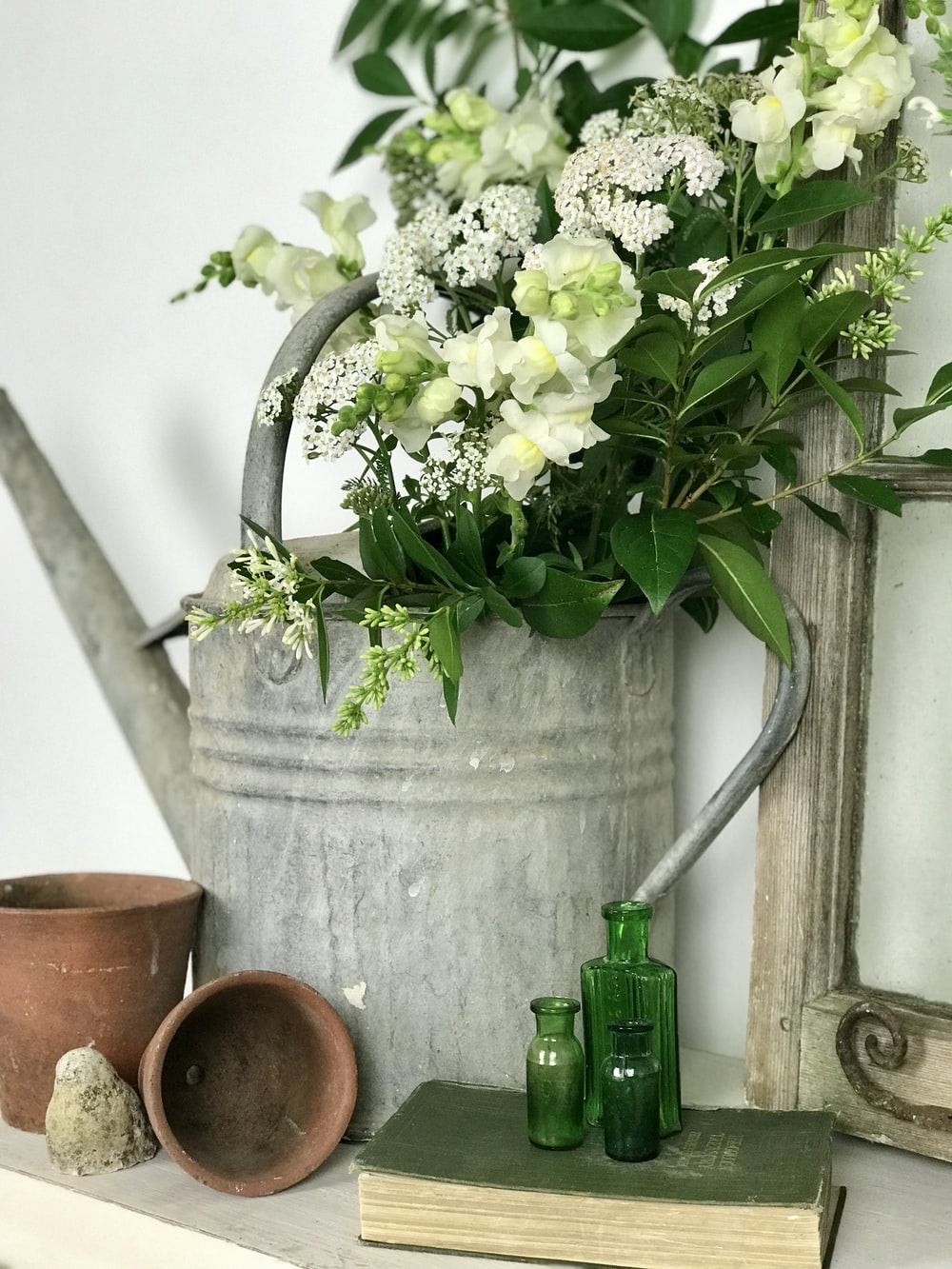 flowers in watering can