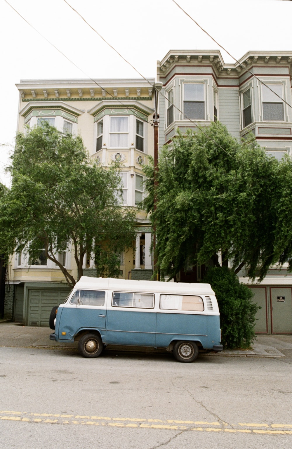 blue and white van near the building
