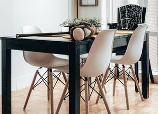 black wooden table and white chairs