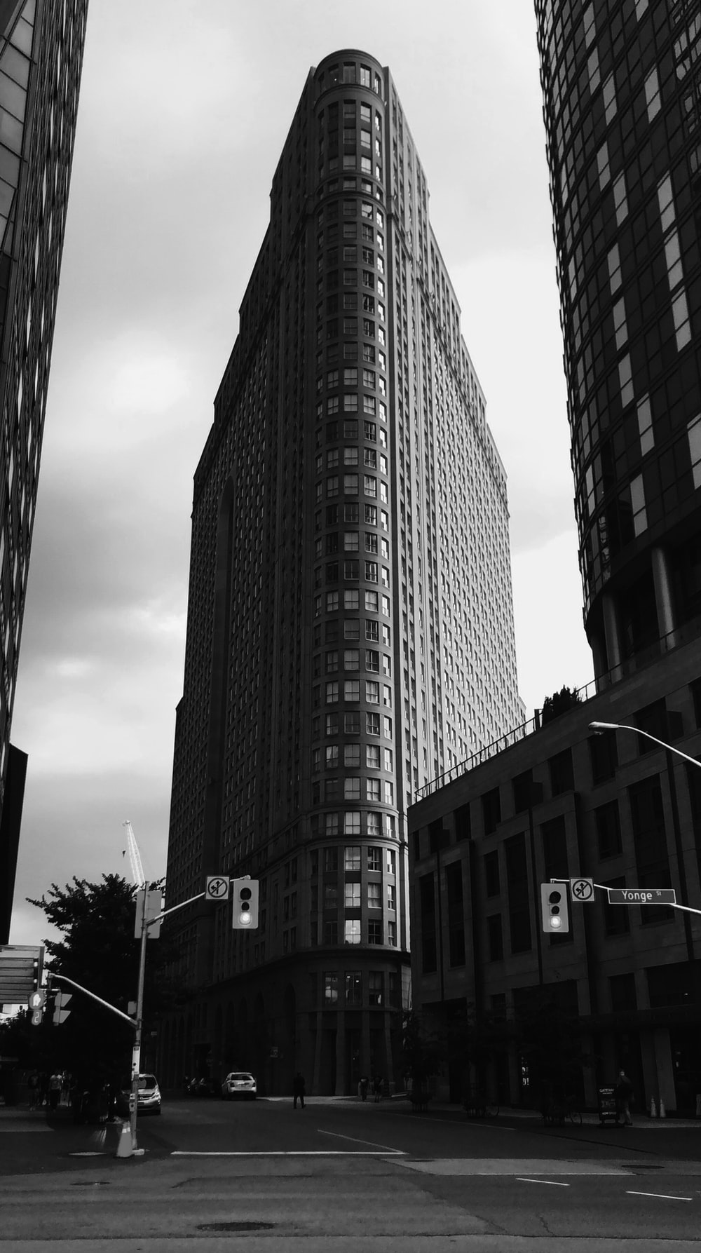 grayscale photography of Flatiron building in New York City
