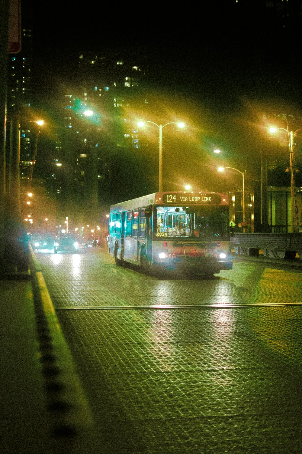 grey bus on road