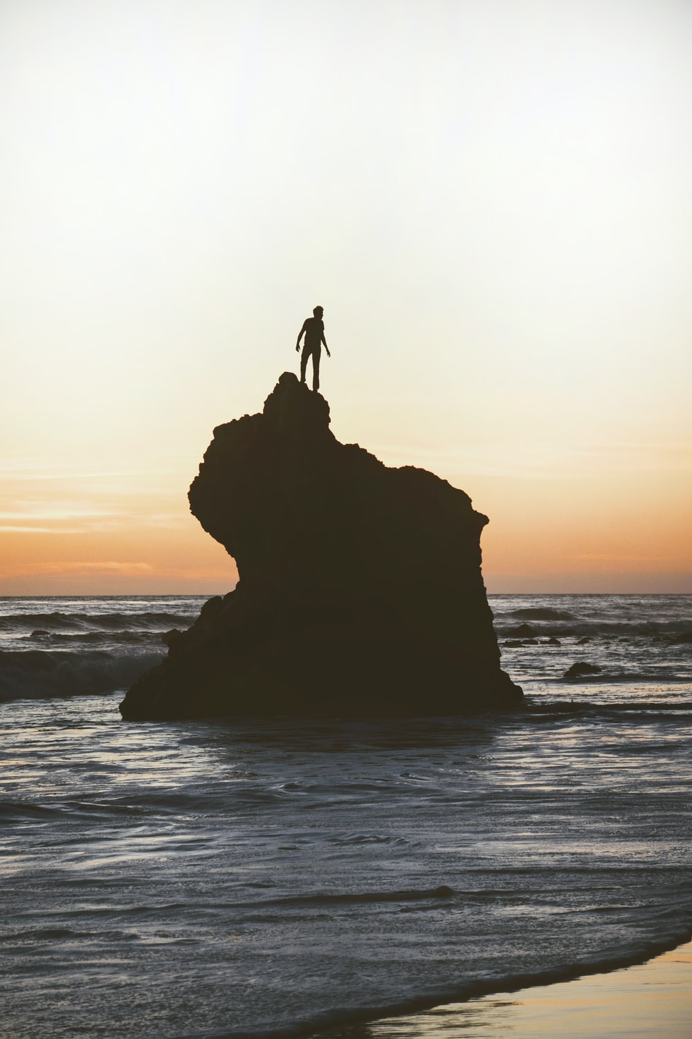 silhouette of a man on a rock