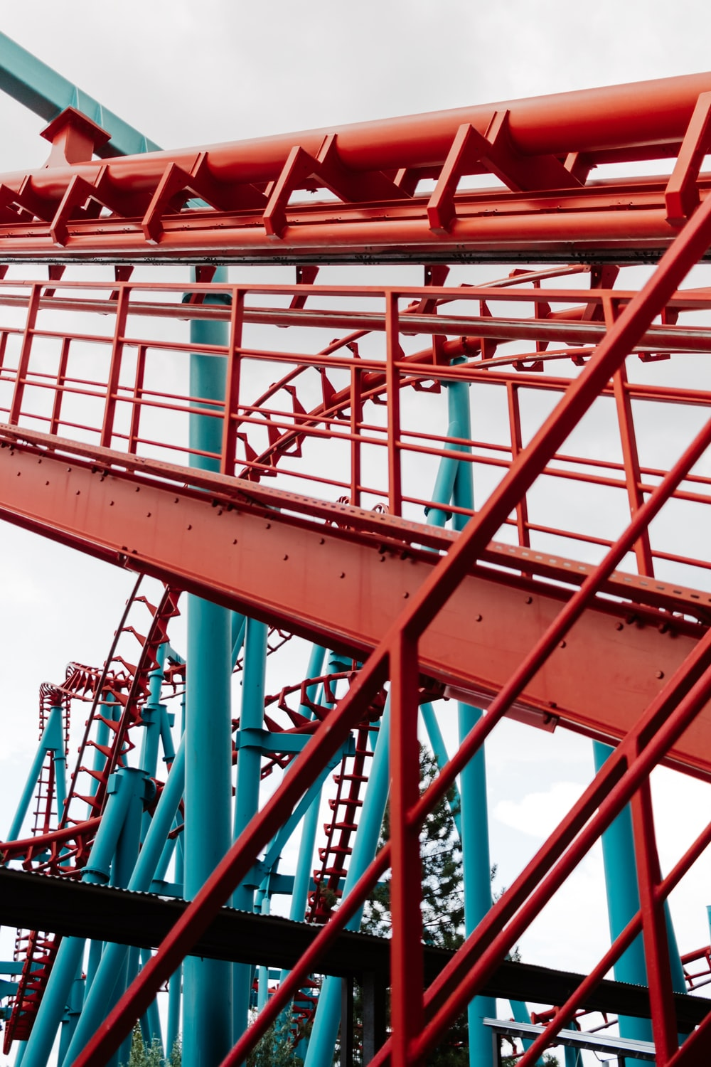 green and red metal roller coaster rails