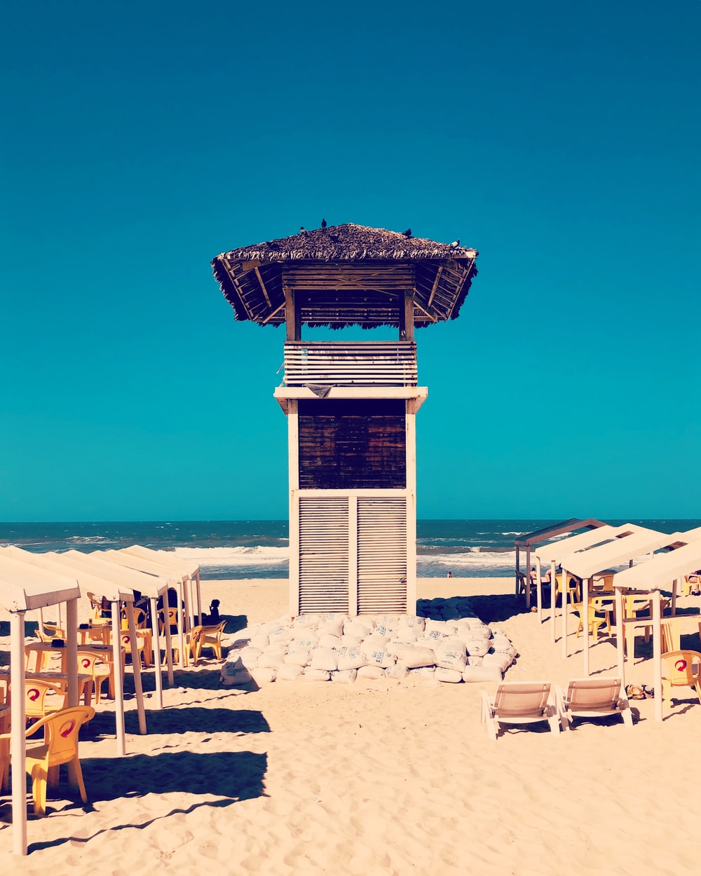 brown and white wooden lifeguard tower
