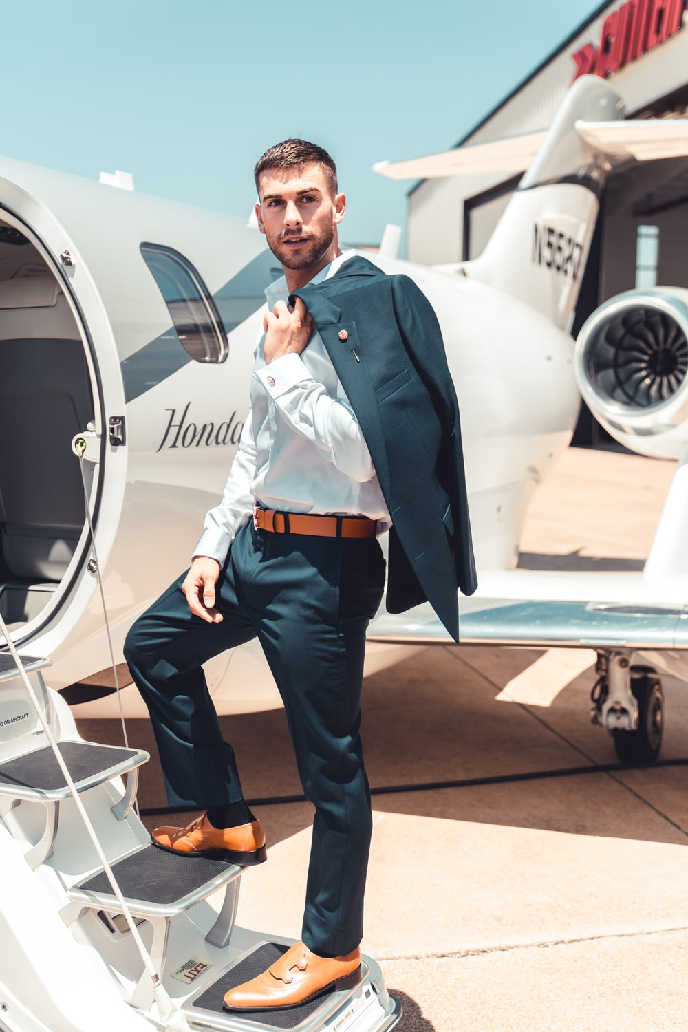 man standing on plane stairs