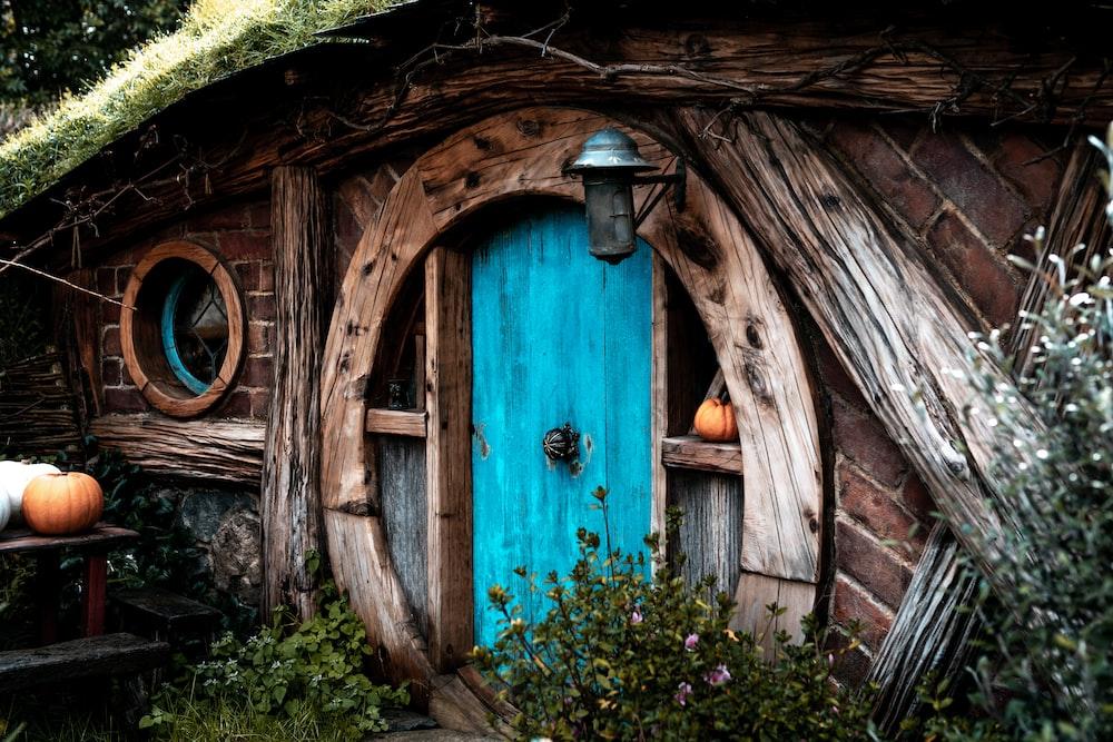 brown wooden house showing closed door