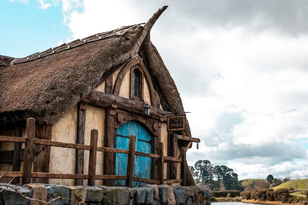 brown and beige house with blue door