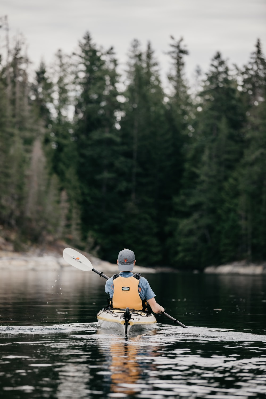 person sitting on kayak during daytime