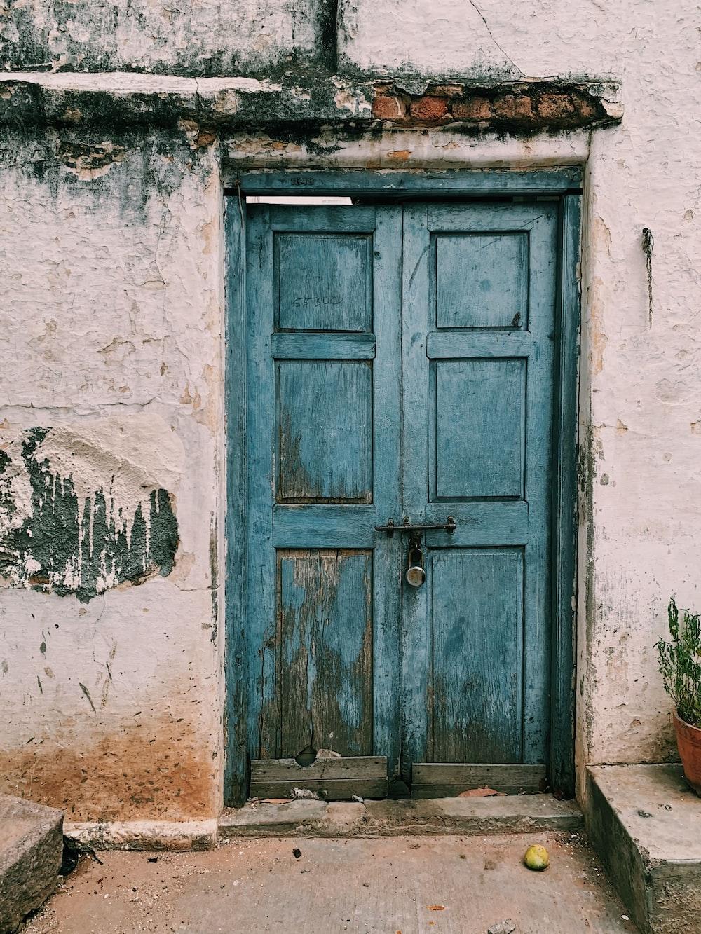 blue wooden 6-paneled door