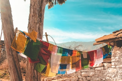 assorted colorful textiles in a clothesline bhutan teams background