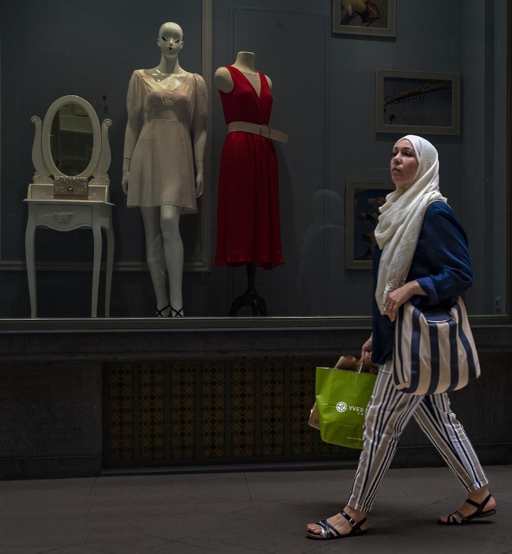 woman walks on road