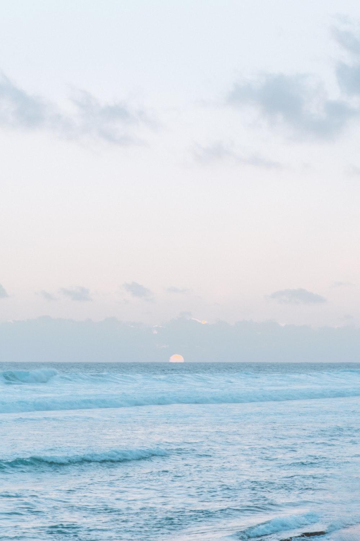 landscape photo of the sea at sunrise