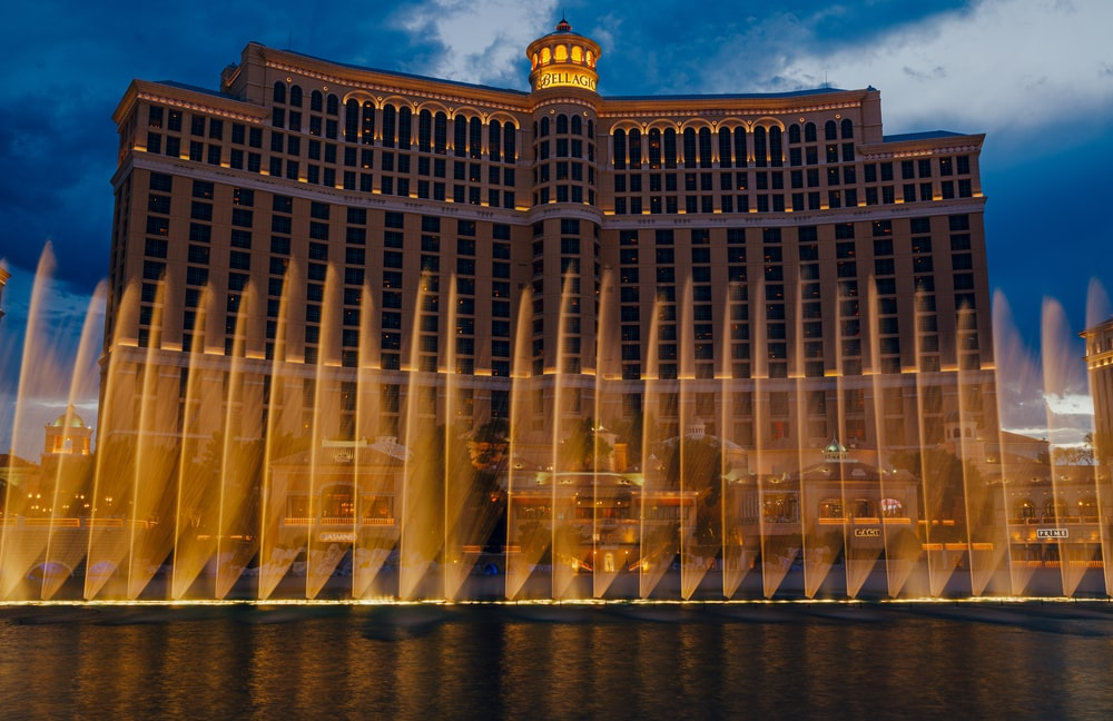 landscape photo of a building and fountain at Las Vegas