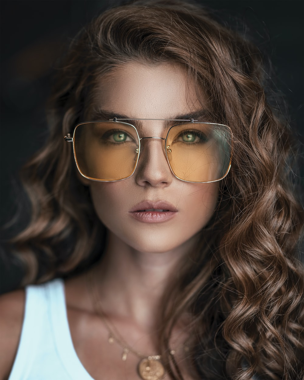 woman wearing brown sunglasses
