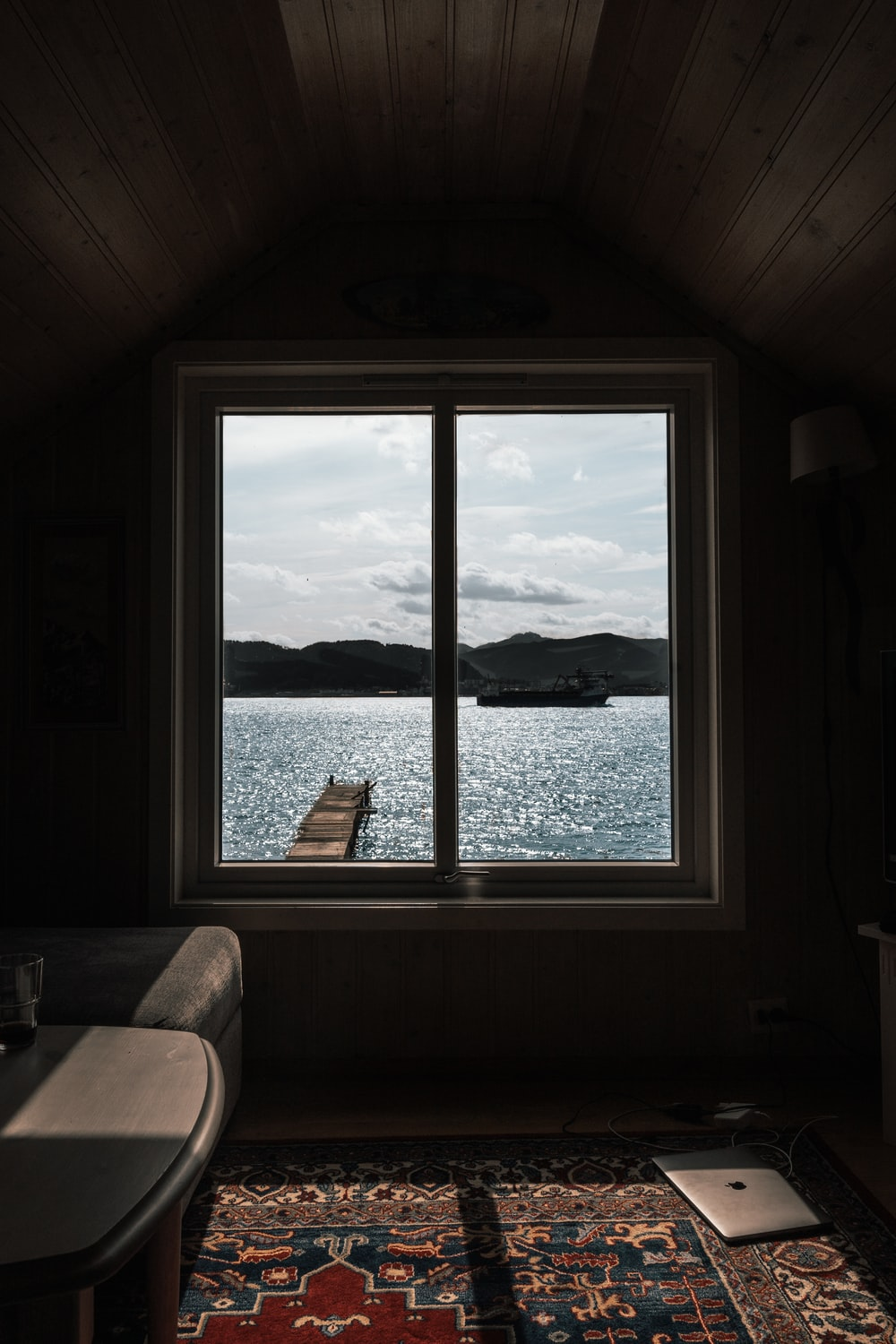 boat in body of water through glass window