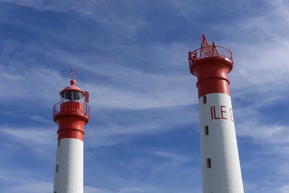 two red-and-white lighthouses