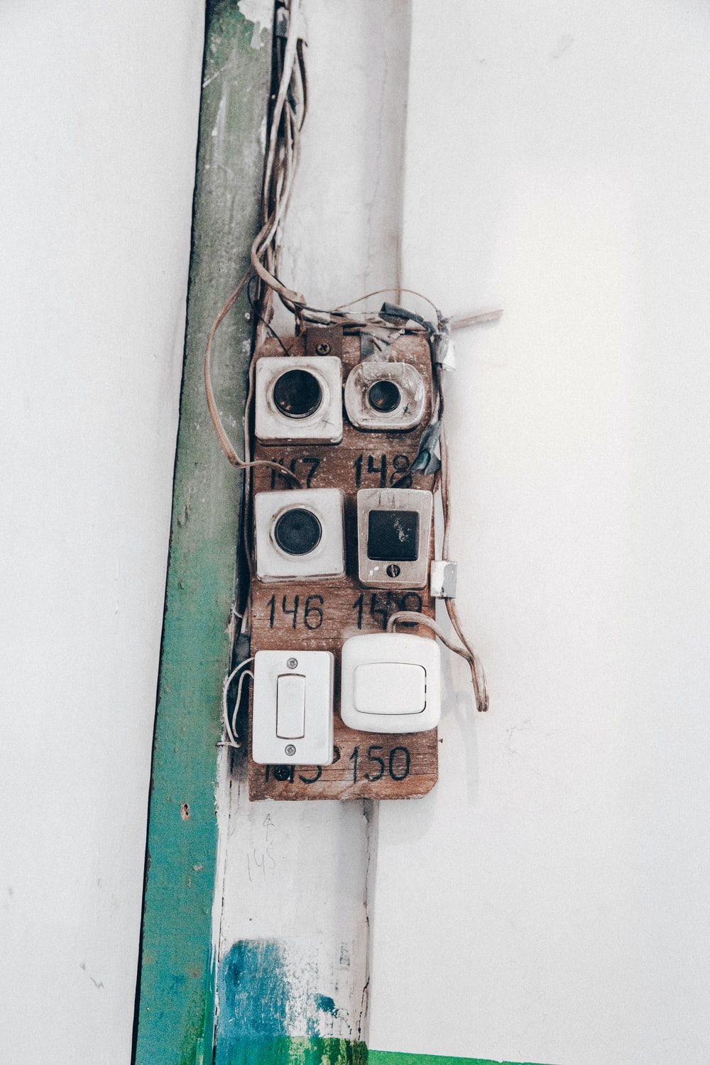 white wall switch close-up photography