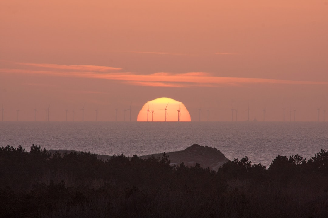 Windmils in the Northsee with te sun goes down