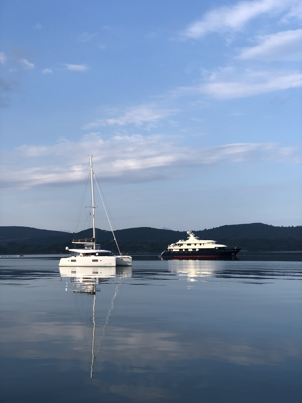 white boats in sea under blue sky