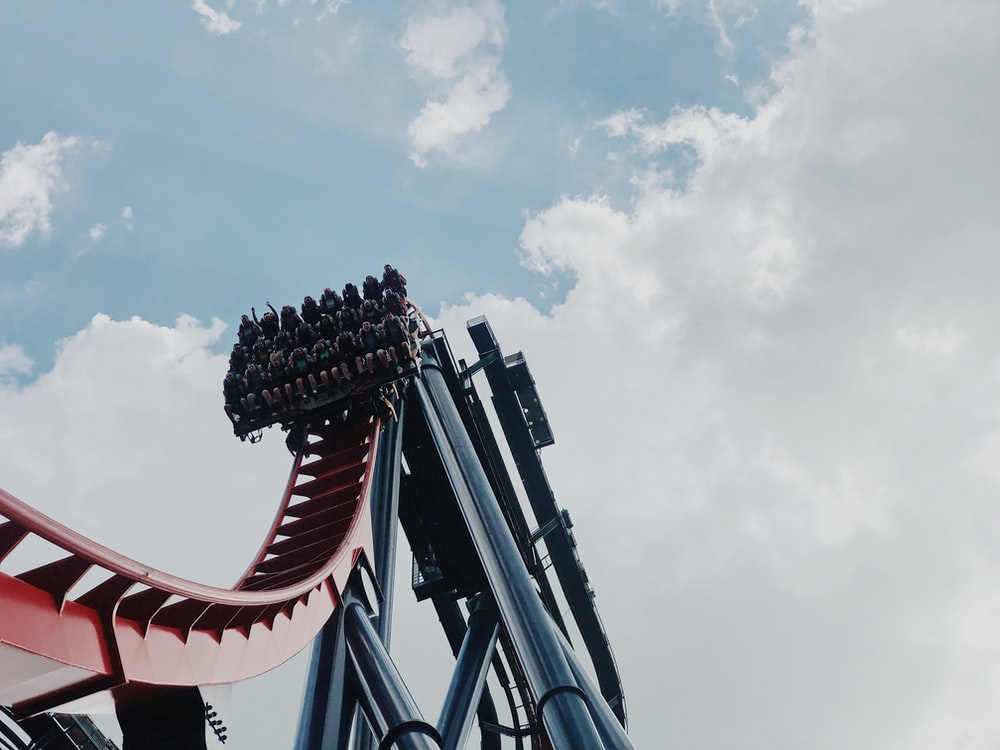 people riding on roller coaster