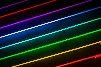 green, orange, red, blue, and purple striped lights neon zoom background