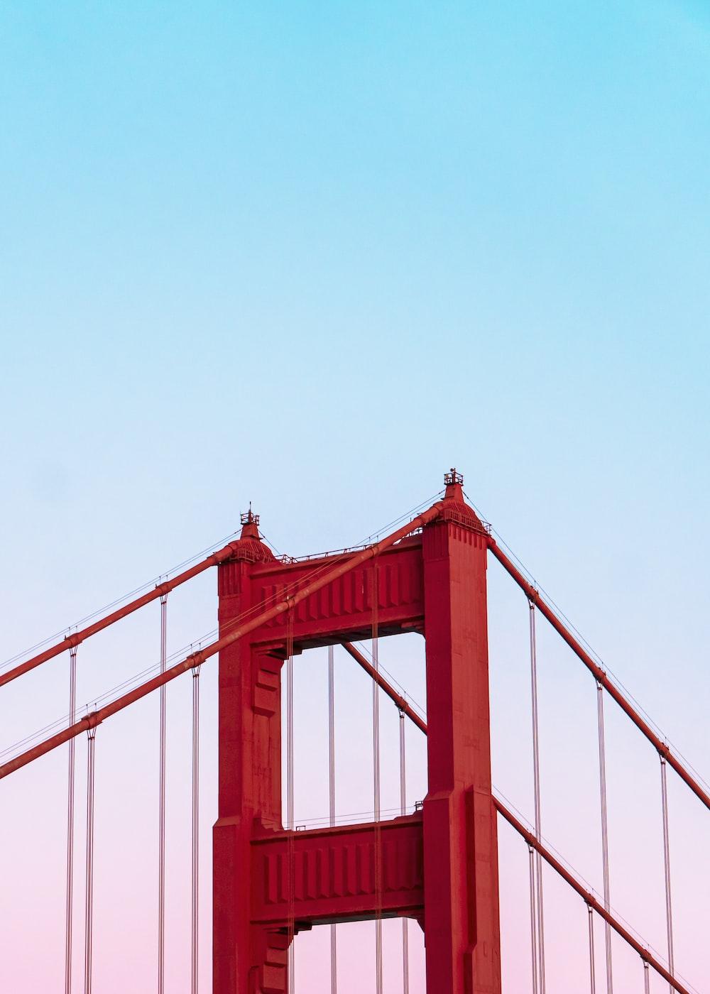 Golden Gate Bridge under a calm blue sky
