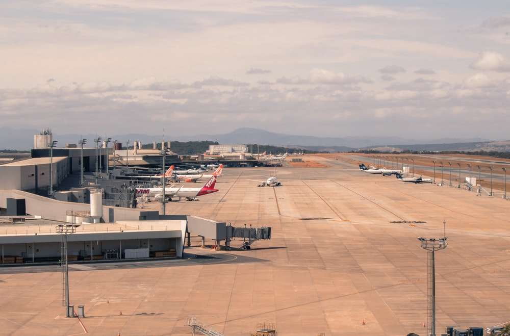 several planes at airport during daytime