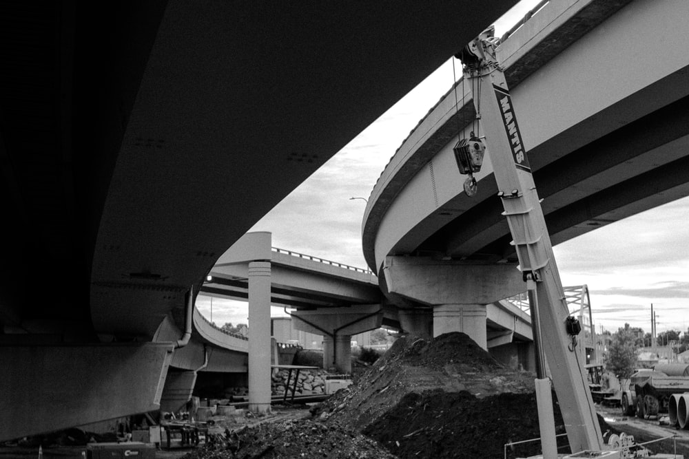 grayscale photography of concrete flyover roads