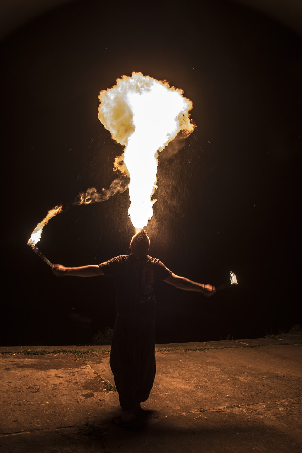 person performing fire arts