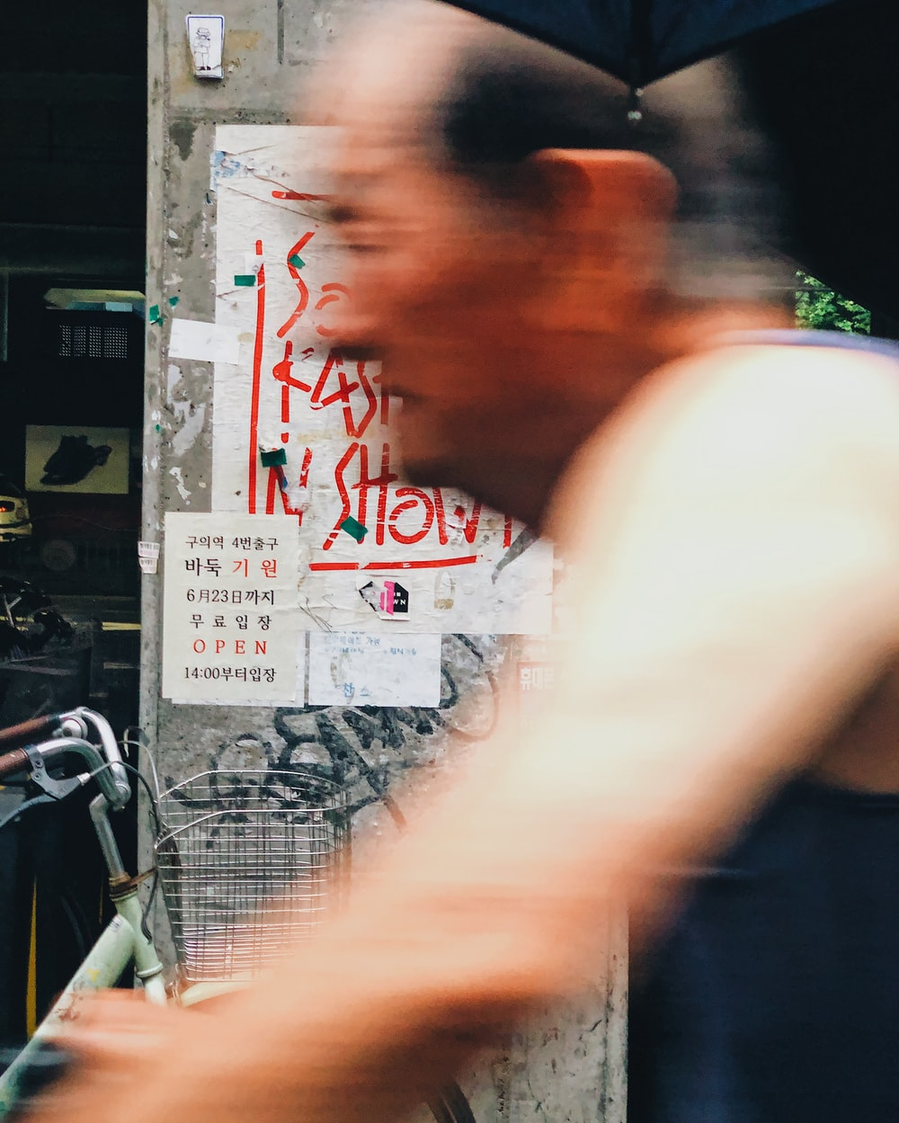 time-lapse photography of man passing by a street