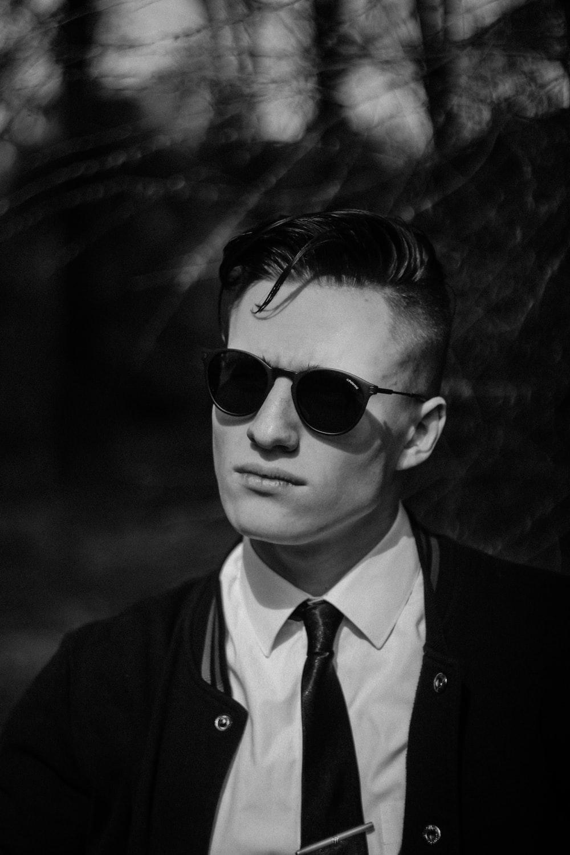 man wears black frame sunglasses