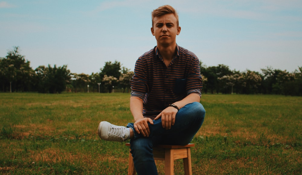 Superb Man Sitting On Wooden Stool On A Field Photo Free Human Ocoug Best Dining Table And Chair Ideas Images Ocougorg