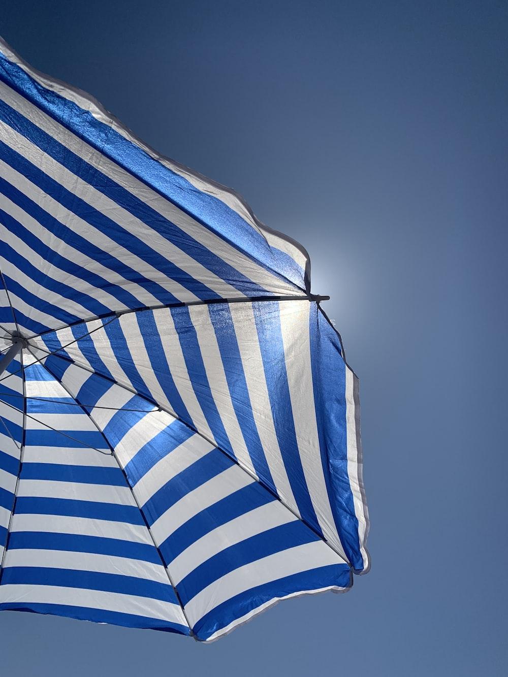 white and blue umbrella
