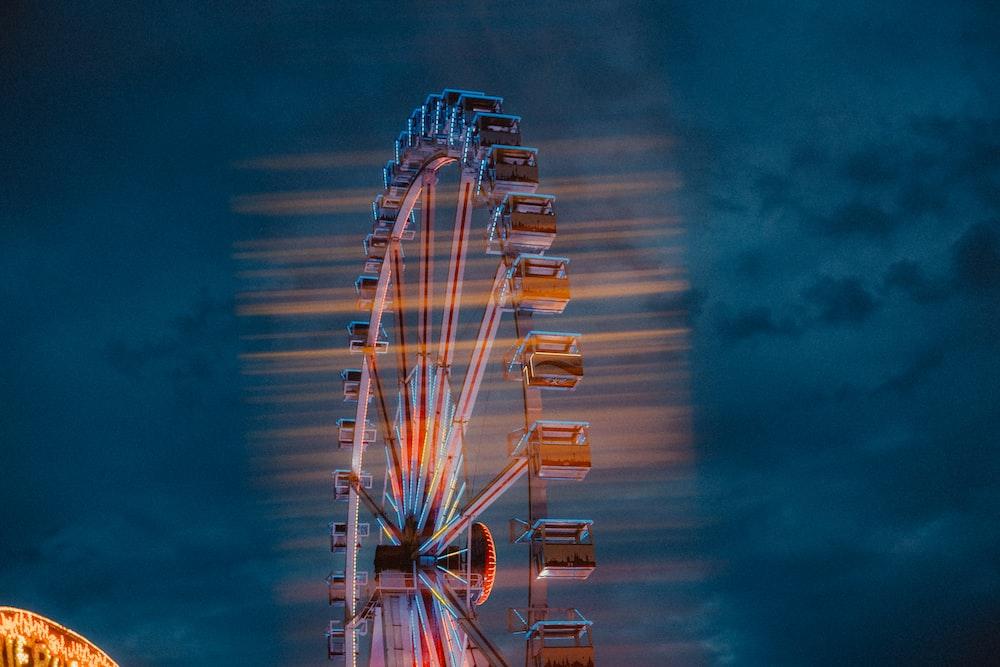 time-lapse photography of orange ferris wheel during night time