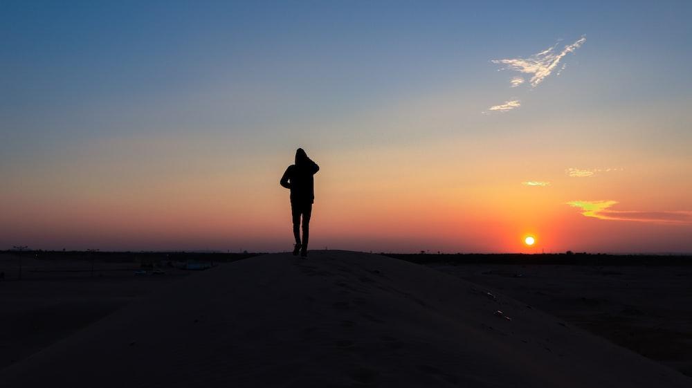 person walks on desert