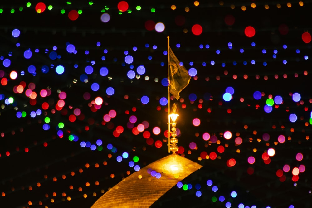 flag surrounded with colored bokeh lights