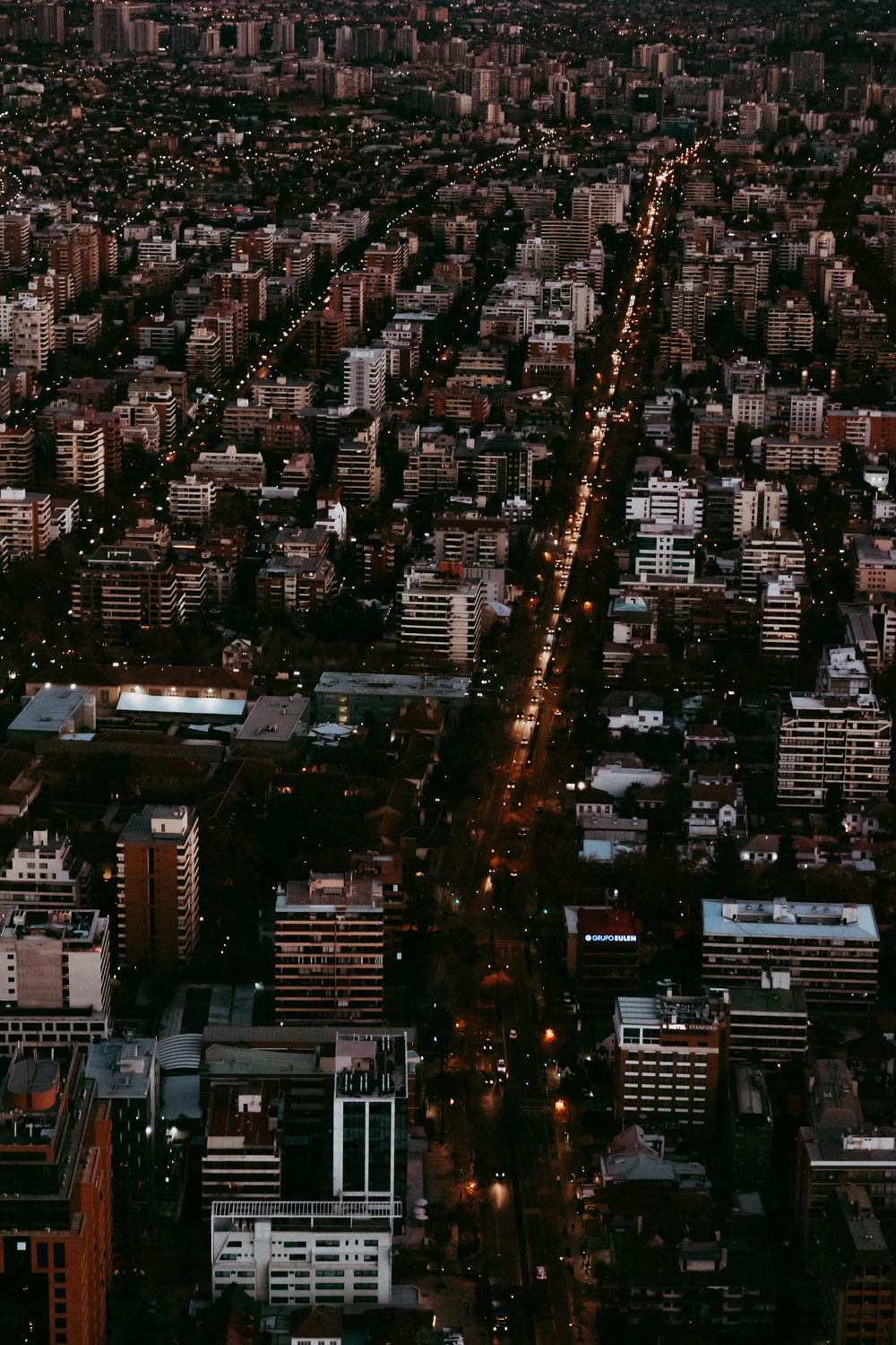 aerial photography of city with high-rise buildings during night time