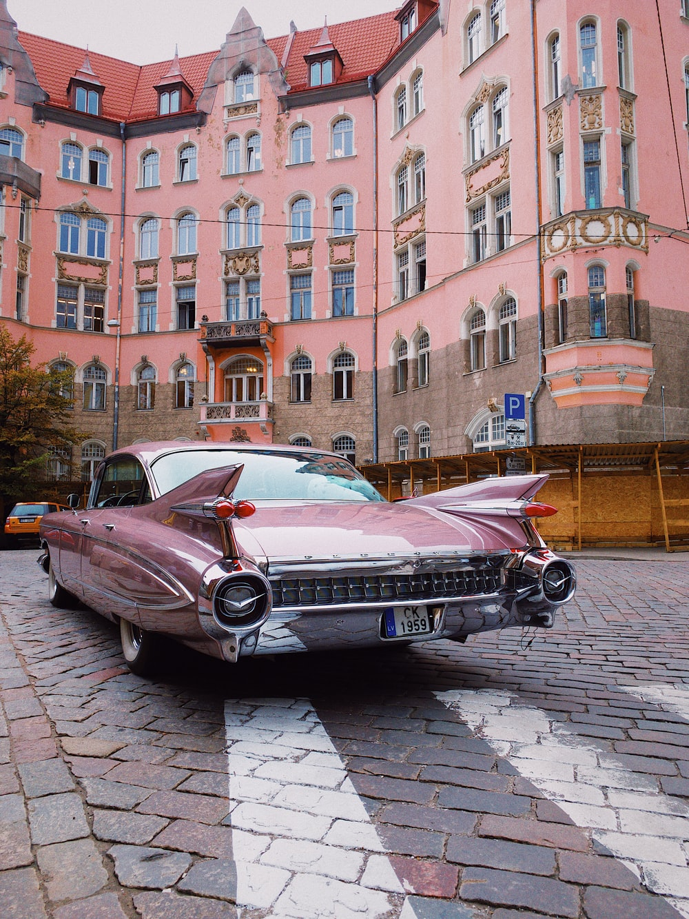 pink coupe in city