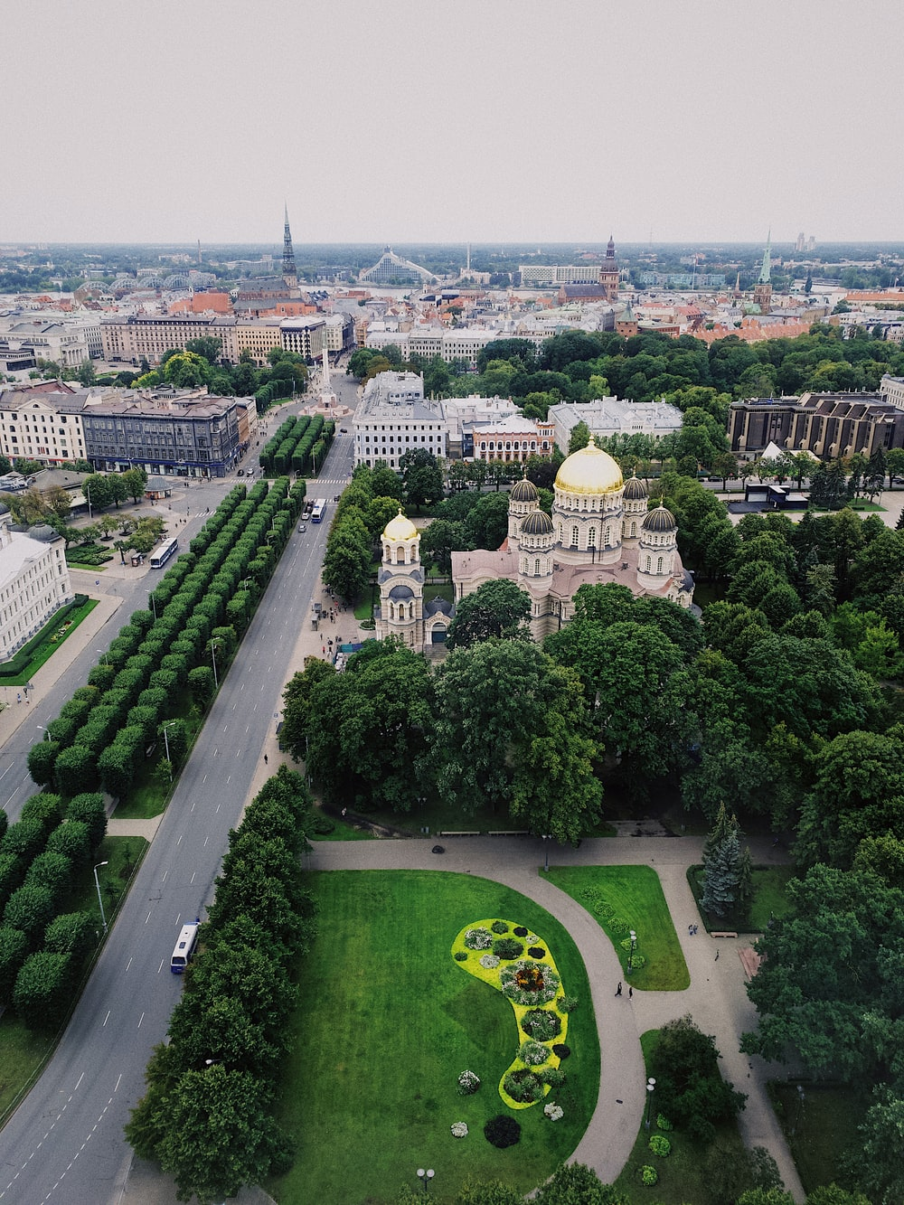 aerial view of city with garden and dome building