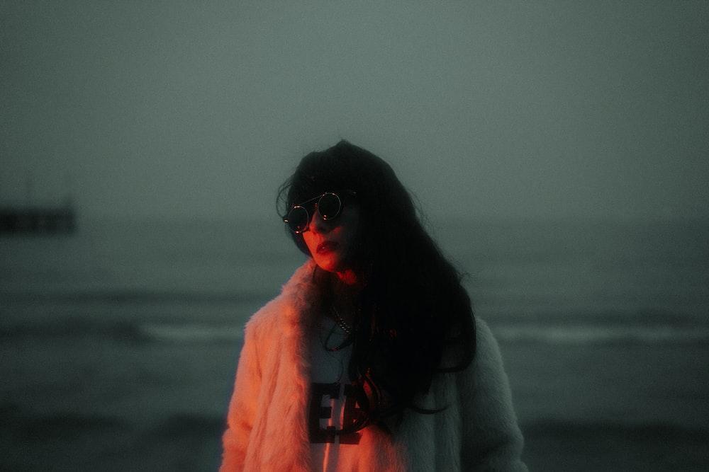 woman wearing white fur jacket