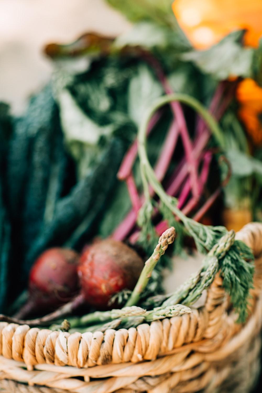 vegetables on brown wicker basket