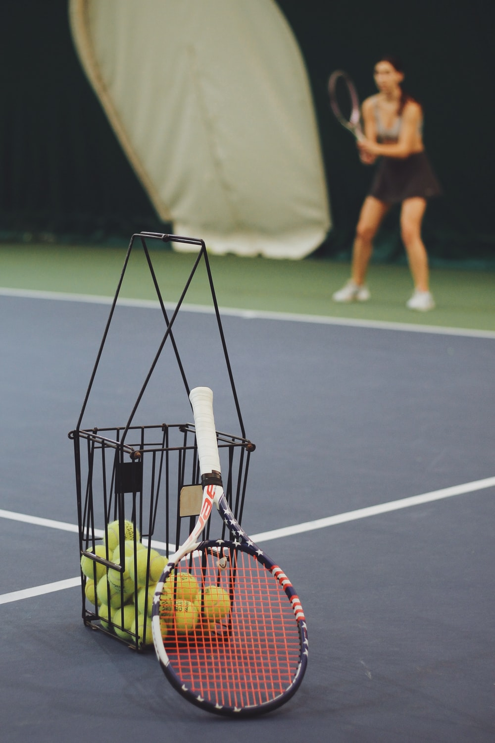 woman standing and holding tennis racket at the tennis court