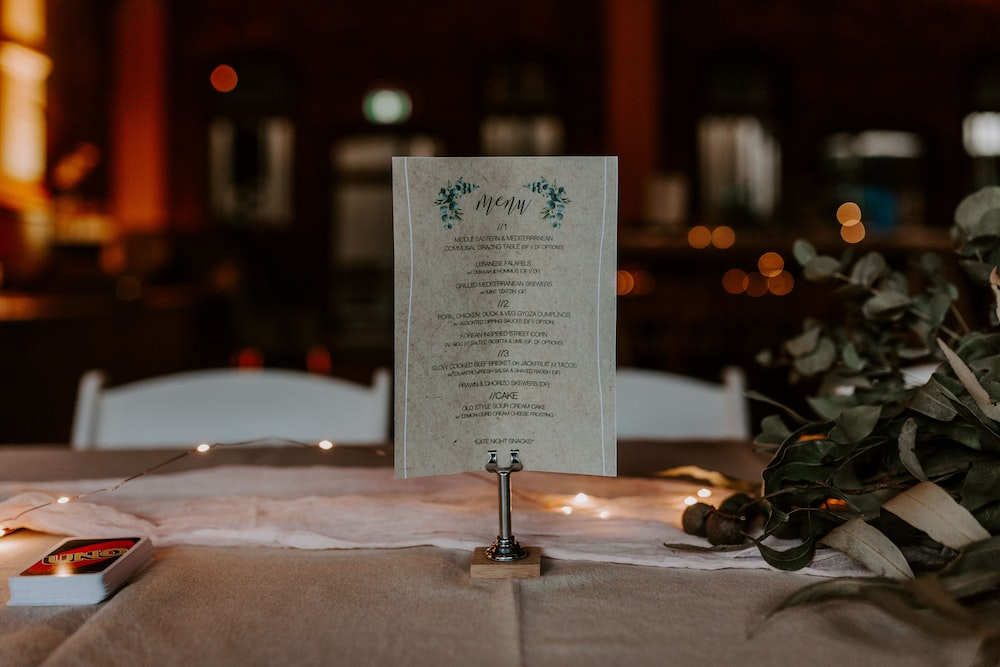 white menu with stand on the table