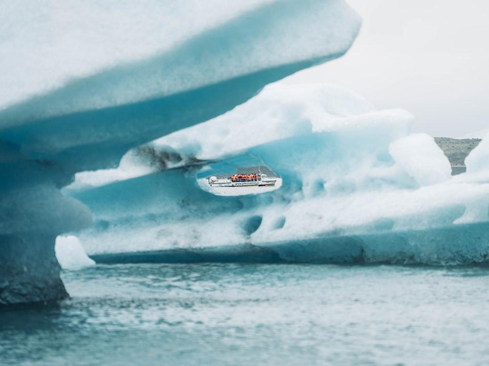 iceberg in body of water