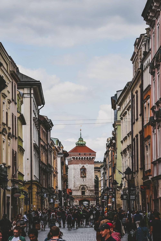 people walking beside buildings during daytime