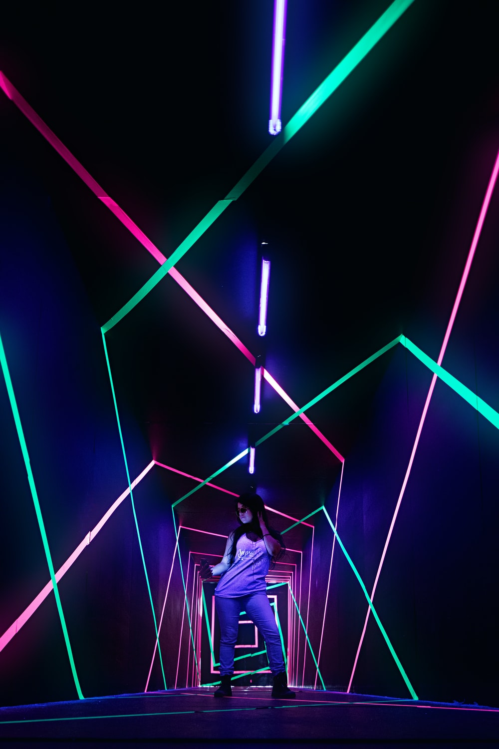 man standing in a LED archway