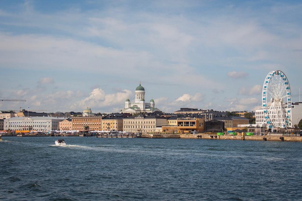 ferris wheel and buildings near water